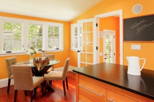 orange-dining-room-with-white-windows