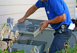 technician-working-on-air-conditioner-outside-unit