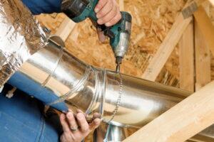 technician-hands-installing-ductwork