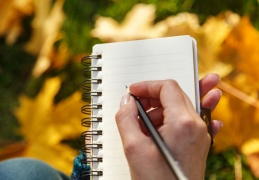 hand-writing-list-in-notebook