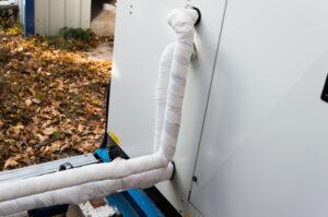 refrigerant-line-behind-ac