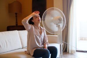 woman-sitting-in-front-of-fan-looking-hot