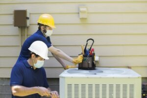 two-technicians-working-on-ac-unit